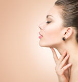 Beautiful spa woman touching her face Stock Image