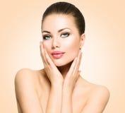 Beautiful spa woman touching her face Stock Photos