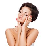Beautiful Spa Woman Touching her Face. Stock Images