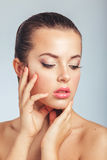 Beautiful Spa Woman Touching her Face. Youth and Skin Care Stock Photography