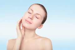 Beautiful spa woman touching her face Stock Photography