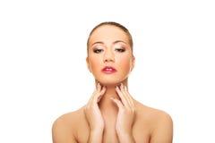 Beautiful spa woman touching her neck. Stock Image