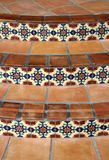 Beautiful Spanich Tile. Photograph of Spanish or Mexican style tiles with colorful motif on a curved stairway. The tiles create an interesting pattern Stock Images