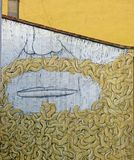 Snake Beard Man - Street Art of Valencia. The beautiful Spanish city of Valencia prides itself on a vibrant, flourishing graffiti scene, making walking round the royalty free stock photography