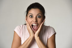 Beautiful Spanish surprised woman amazed in shock and surprise happy and excited Royalty Free Stock Image