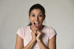 Beautiful Spanish surprised woman amazed in shock and surprise happy and excited. Head portrait of young beautiful Spanish surprised woman amazed in shock and Stock Image