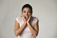 Beautiful Spanish surprised woman amazed in shock and surprise happy and excited Stock Photography