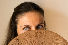 Beautiful Spanish woman at the april fair in a very hot day Royalty Free Stock Photo