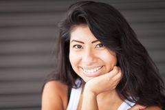 Beautiful Spanish Woman smiling and relaxing. Isolated stock image
