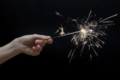Beautiful sparkler in hand on black background Royalty Free Stock Photography