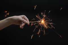Beautiful sparkler in hand on black background Stock Photography