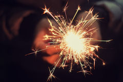 Beautiful sparkler in woman hands Stock Photo