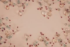 Sparkling colorful strass decoration on pastel colored background. Top view. royalty free stock photos