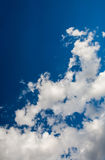 Beautiful sparse clouds in the blue sky Stock Images