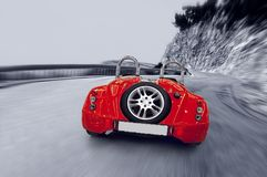 Beautiful speed red sportcar on the road. Street royalty free stock image