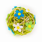 Beautiful sphere made of bound wicker with florets Royalty Free Stock Photos