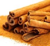 Beautiful spice. Macro photo of cinnamon bark and powder isolated on white stock photos