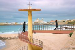 Beautiful spiral staircase leading from the beach to the promenade. Spain, Cadiz, February 2018 Stock Photography