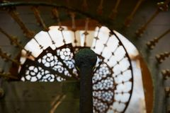 Beautiful spiral staircase with old rusty handrail royalty free stock photo