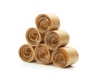 Beautiful spiral wood shavings. Created by a hand plane. stacked up to form a triangle royalty free stock image