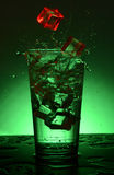 Beautiful splash cocktail with ice. Royalty Free Stock Photography