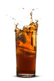 Beautiful splash of cola in glass Royalty Free Stock Photos