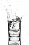A beautiful splash of ice in a glass of water Royalty Free Stock Photo