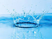 Beautiful splash of water. Blue drops Royalty Free Stock Photography
