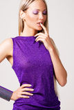 Beautiful splendid woman in violet gown Royalty Free Stock Images