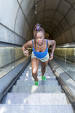 Beautiful sport african woman exercise and climb stairs, health Stock Photos