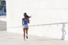 Beautiful sport african woman in the street, health lifestyle c Stock Image