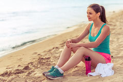 Beautiful sport girl on the beach royalty free stock images