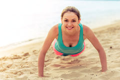Beautiful sport girl on the beach Stock Photo