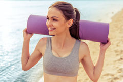 Beautiful sport girl on the beach royalty free stock image