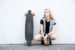 Beautiful sport girl with a longboard. A young girl walks and rides a longboard Stock Images