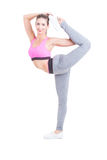 Beautiful sport girl stretching like a ballerina. Beautiful sport girl stretching before workout like a ballerina isolated on white background Stock Photos