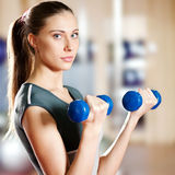 Beautiful sport woman doing exercise with dumbbell Royalty Free Stock Photography