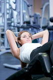 Beautiful sport woman doing press exercise. Beautiful sport woman doing press fitness exercise at sport gym Royalty Free Stock Images