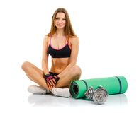 Beautiful sport woman with dumbbells, mat for fitness, a bottle Royalty Free Stock Photography