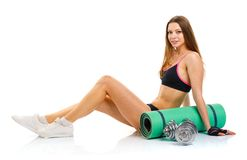 Beautiful sport woman with dumbbells, mat for fitness, a bottle Stock Photo