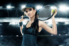 Beautiful sport woman tennis player with racket in blue costume Stock Image