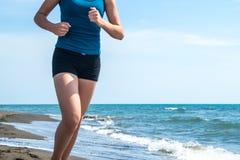 Beautiful sportive girl running along beautiful sandy beach, hea. Lthy lifestyle Royalty Free Stock Photos