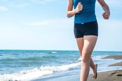 Beautiful sportive girl running along beautiful sandy beach, hea. Lthy lifestyle Royalty Free Stock Image