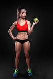 Beautiful sportly fitness girl holding an apple Stock Images