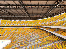Beautiful sports arena for ice hockey with yellow seats and VIP boxes Royalty Free Stock Photography