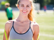 Beautiful sports blonde the woman with a jump rope at stadium. S Stock Photo