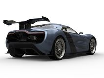 Beautiful sports car - shadow blue metallic color - back view closeup Stock Photography