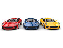 Beautiful sports cars in primary colors. Isolated on white background Royalty Free Stock Images