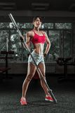 Beautiful sports fitness girl with a barbell Stock Photo