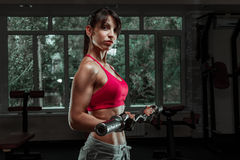 Beautiful sports fitness girl with a barbell Royalty Free Stock Photography